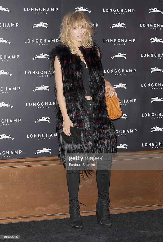Suki Waterhouse attends the grand opening party of Longchamp Regent Street at Longchamp on September 14, 2013 in London, England.