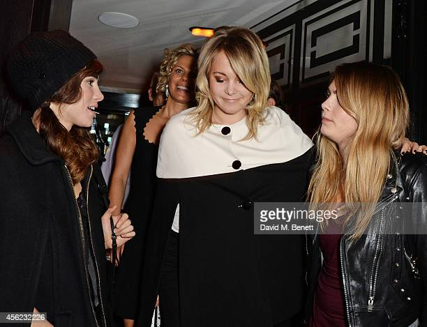 Suki Waterhouse Poppy Jamie and Cara Delevingne attend as Lauryn Hill performs at the Dover Street Arts Club on September 27 2014 in London England