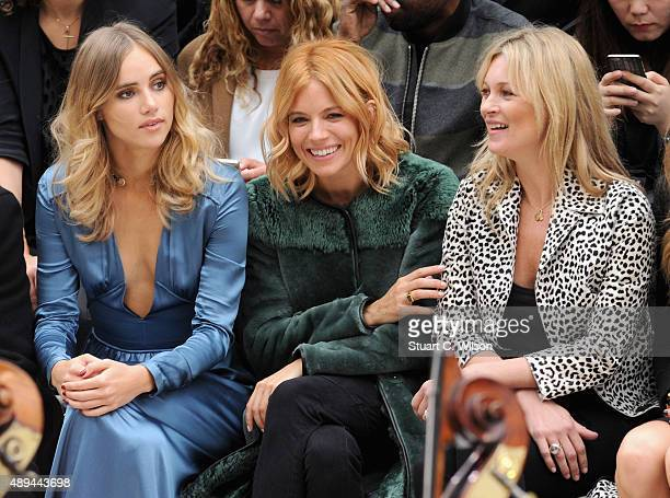 Suki Waterhouse Sienna Miller and Kate Moss attend the Burberry Womenswear Spring/Summer 2016 show during London Fashion Week at Kensington Gardens...