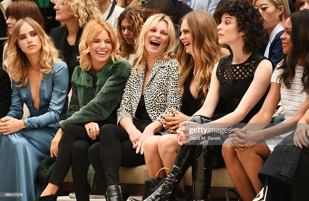 Suki Waterhouse, Sienna Miller, Kate Moss, Cara Delevingne, Annie Clark and Naomie Harris attend the Burberry Womenswear Spring/Summer 2016 show during London Fashion Week at Kensington Gardens on September 21, 2015 in London, England.