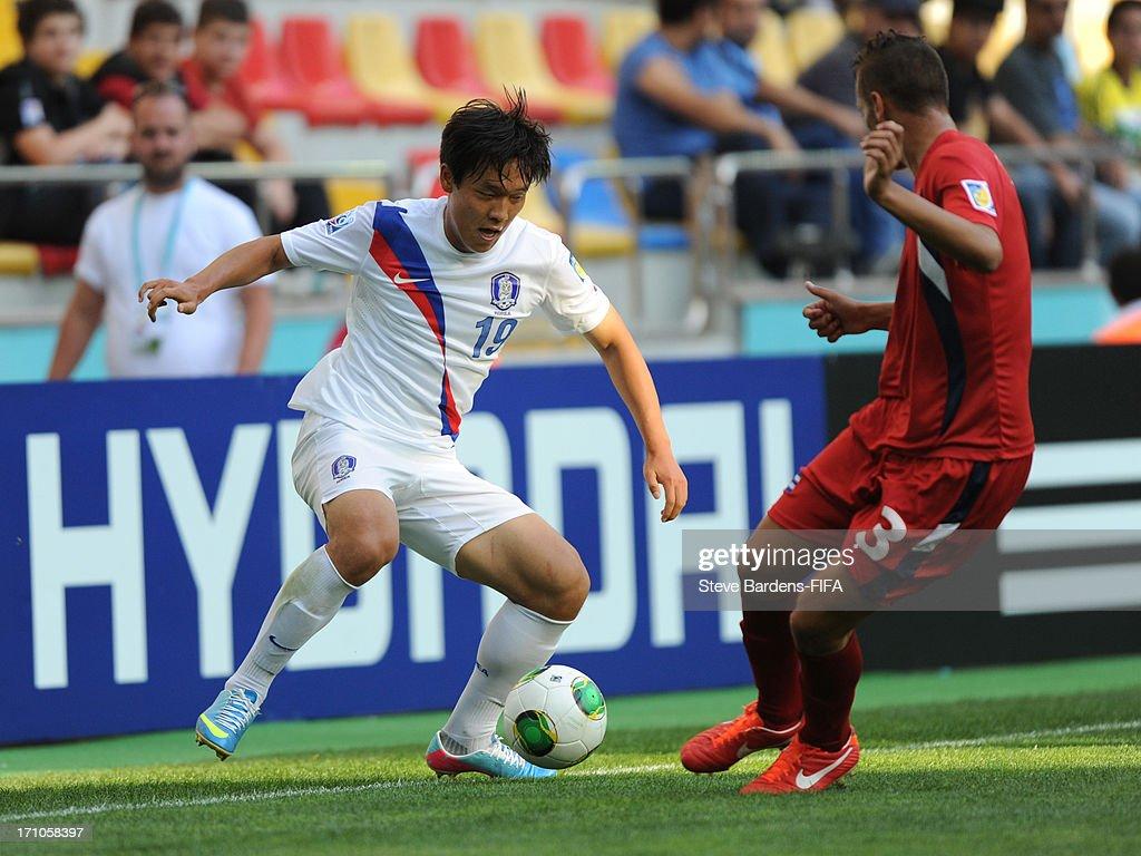 Sukjae Cho of Korea Republic takes on Emmanuel Labrada of Cuba during the FIFA U-20 World Cup Group B match between Cuba and Korea Republic at Kadir Has Stadium on June 21, 2013 in Kayseri, Turkey.