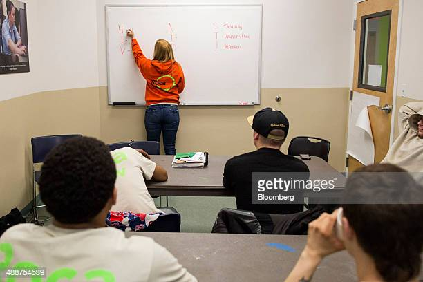 Sulai Rosa a case worker at Roca teaches a class on sexually transmitted diseases at Roca headquarters in Chelsea Massachusetts US on April 15 2014...