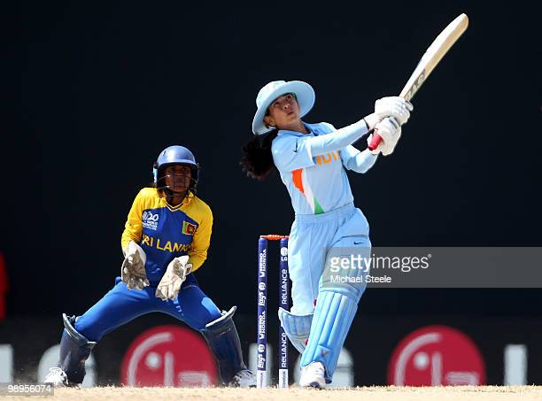 Sulakshana Naik of India hits out as wicketkeeper Dilani Manodara looks on during the ICC T20 Women's World Cup Group B match between India and Sri...