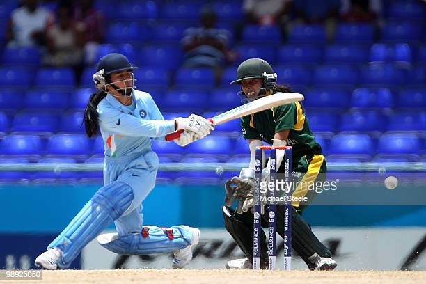 Sulakshana Naik of India sweeps during the ICC T20 Women's World Cup Group B match between India and Pakistan at Warner Park on May 8 2010 in St...