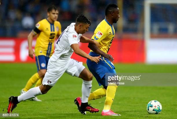 Suleiman Abdullahi of Braunschweig and John Patrick Strauss of Aue battle for the ball during the Second Bundesliga match between Eintracht...