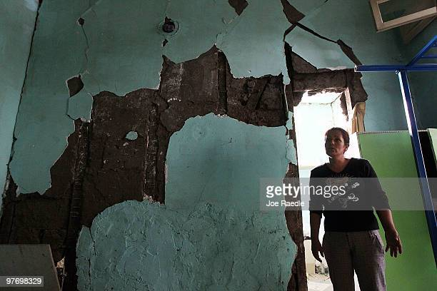 Sulema Puebla stands in one of the rooms in her apartment that had damage during the Feb 27th earthquake on March 14 2010 in Santiago Chile Even...