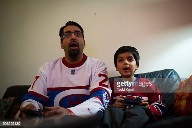 Sulemaan Ahmed plays video games with his six year old son Adam Syed Ahmed at their home in Toronto Ontario Adam Ahmed is on a list the requires an...