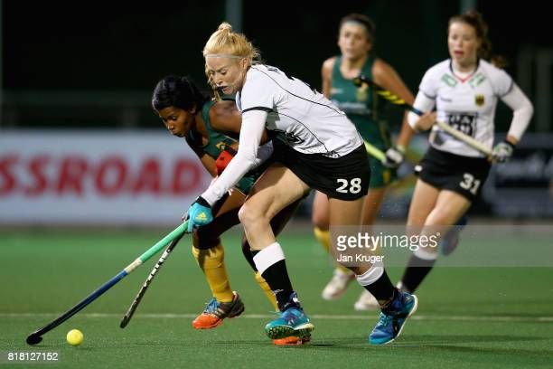Sulette Damons of South Africa and Nina Notman of Germany battle for possession during the Quarter Final match between Germany and South Africa...