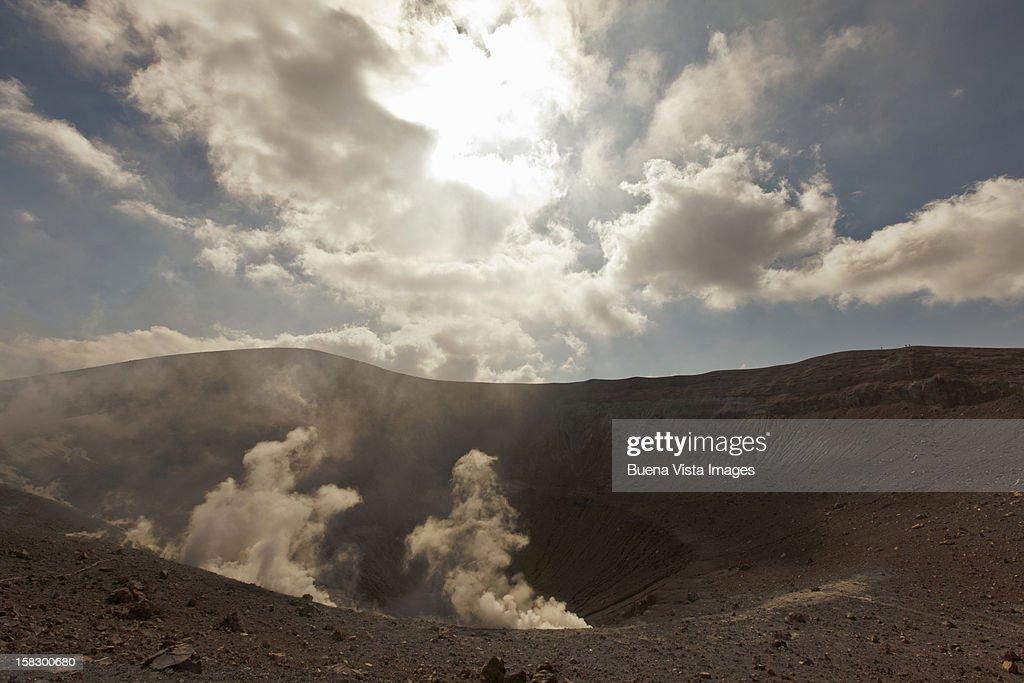 sulfur vapor in a vulcano crater : Stock Photo