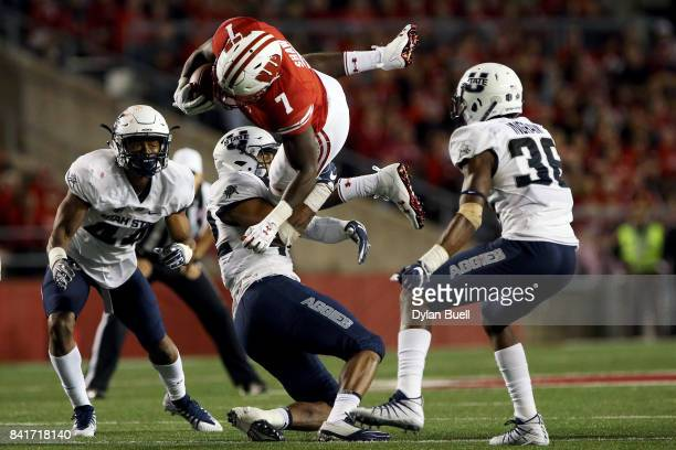 Suli Tamaivena of the Utah State Aggies tackles Bradrick Shaw of the Wisconsin Badgers in the third quarter at Camp Randall Stadium on September 1...
