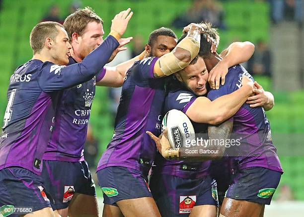 Suliasi Vunivalu of the Storm is congratulated by his teammates after scoring the Storms first try during the NRL Qualifying Final match between the...