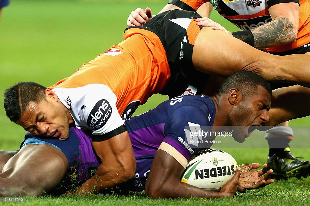 Suliasi Vunivalu of the Storm is hit high during the round 16 NRL match between the Melbourne Storm and Wests Tigers at AAMI Park on June 26, 2016 in Melbourne, Australia.
