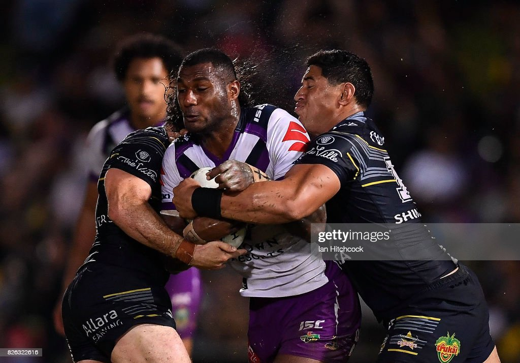 Suliasi Vunivalu of the Storm is tackled by Jason Taumalolo and Jake Granville of the Cowboys during the round 22 NRL match between the North Queensland Cowboys and the Melbourne Storm at 1300SMILES Stadium on August 4, 2017 in Townsville, Australia.