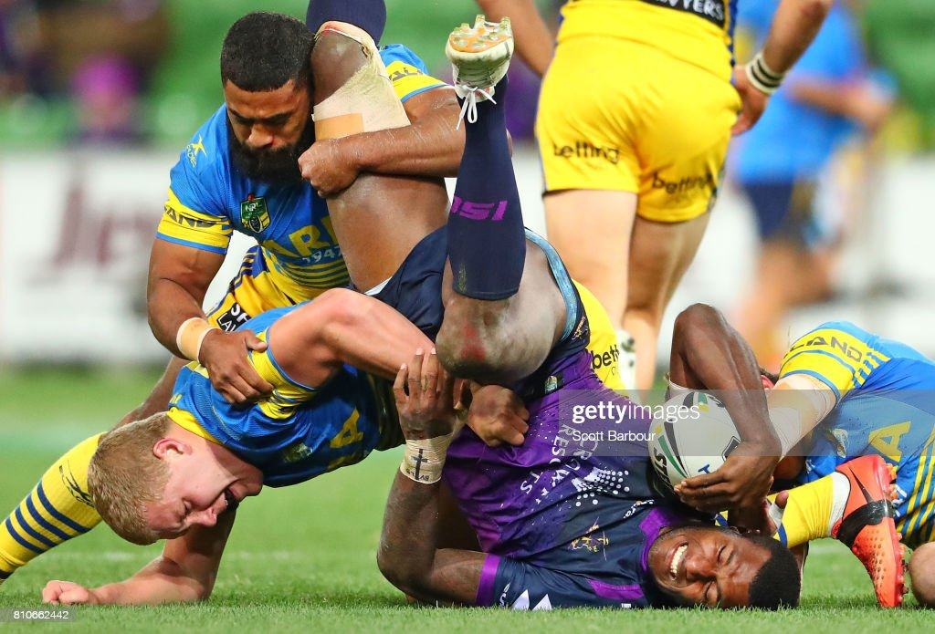 Suliasi Vunivalu of the Storm is tackled during the round 18 NRL match between the Melbourne Storm and the Parramatta Eels at AAMI Park on July 8, 2017 in Melbourne, Australia.