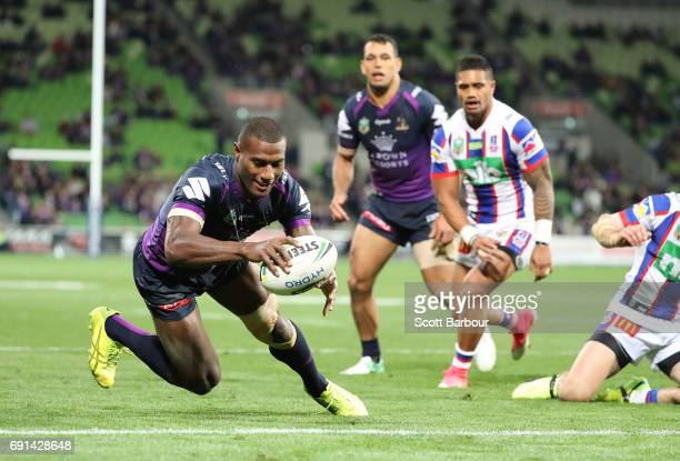 Suliasi Vunivalu of the Storm scores a try during the round 13 NRL match between the Melbourne Storm and the Newcastle Knights at AAMI Park on June 2...
