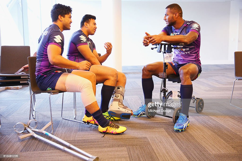 Suliasi Vunivalu (R) waits for the team photo to tae place during a Melbourne Storm NRL media opportunity at AAMI Park on September 26, 2016 in Melbourne, Australia.