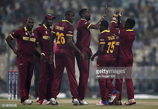 Sulieman Benn of the West Indies celebrate the wicket of Shikhar Dhawan of India with team mates during the ICC World Twenty20 warm up match between...