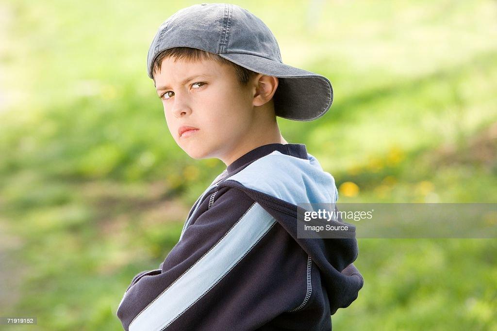 Sulking boy on field : Stock Photo