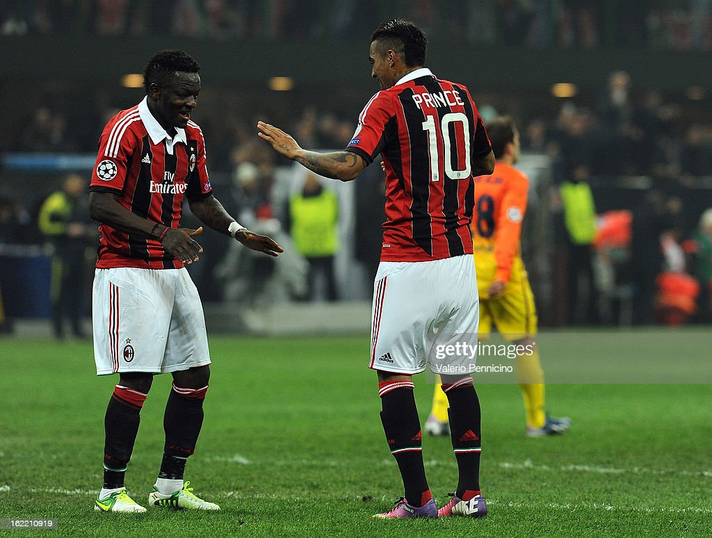 Sulley Ali Muntari (L) of AC Milan celebrates his goal with team-mate Kevin-Prince Boateng during the UEFA Champions League Round of 16 first leg match between AC Milan and Barcelona at San Siro Stadium on February 20, 2013 in Milan, Italy.