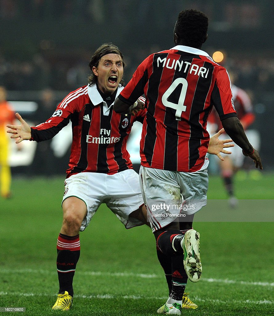 Sulley Ali Muntari (R) of AC Milan celebrates his goal with team-mate Riccardo Montolivo during the UEFA Champions League Round of 16 first leg match between AC Milan and Barcelona at San Siro Stadium on February 20, 2013 in Milan, Italy.