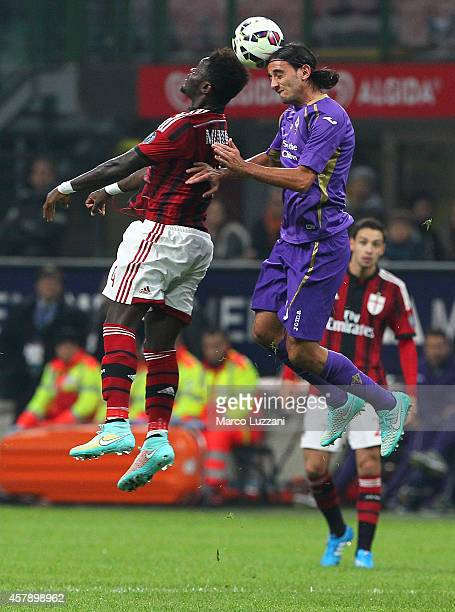 Sulley Ali Muntari of AC Milan competes for the ball with Alberto Aquilani of ACF Fiorentina during the Serie A match between AC Milan and ACF...