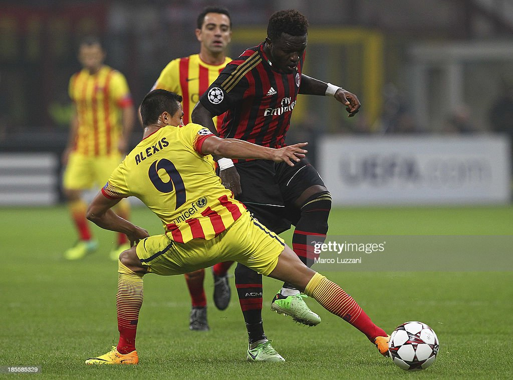 <a gi-track='captionPersonalityLinkClicked' href=/galleries/search?phrase=Sulley+Ali+Muntari&family=editorial&specificpeople=533057 ng-click='$event.stopPropagation()'>Sulley Ali Muntari</a> (R) of AC Milan competes for the ball with <a gi-track='captionPersonalityLinkClicked' href=/galleries/search?phrase=Alexis+Sanchez&family=editorial&specificpeople=5515162 ng-click='$event.stopPropagation()'>Alexis Sanchez</a> (L) of FC Barcelona during the UEFA Champions League Group H match between AC Milan and FC Barcelona at Stadio Giuseppe Meazza on October 22, 2013 in Milan, Italy
