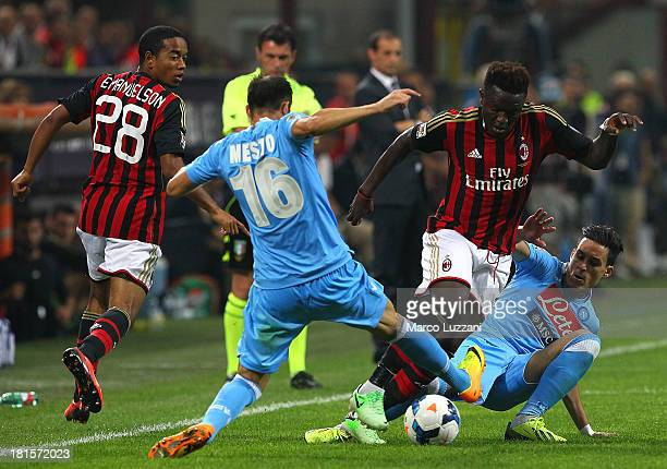 Sulley Ali Muntari of AC Milan competes for the ball with Jose' Maria Callejon and Giandomenico Mesto of SSC Napoli during the Serie A match between...