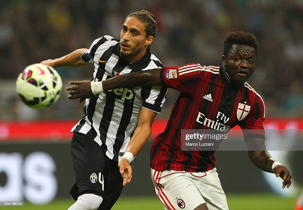 Sulley Ali Muntari of AC Milan competes with Martin Caceres of Juventus FC during the Serie A match between AC Milan and Juventus FC at Stadio...