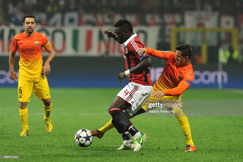 <a gi-track='captionPersonalityLinkClicked' href=/galleries/search?phrase=Sulley+Ali+Muntari&family=editorial&specificpeople=533057 ng-click='$event.stopPropagation()'>Sulley Ali Muntari</a> (L) of AC Milan is tackled by <a gi-track='captionPersonalityLinkClicked' href=/galleries/search?phrase=Alexis+Sanchez&family=editorial&specificpeople=5515162 ng-click='$event.stopPropagation()'>Alexis Sanchez</a> of Barcelona during the UEFA Champions League Round of 16 first leg match between AC Milan and Barcelona at San Siro Stadium on February 20, 2013 in Milan, Italy.