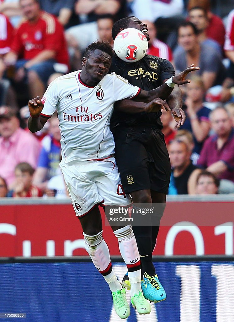 <a gi-track='captionPersonalityLinkClicked' href=/galleries/search?phrase=Sulley+Ali+Muntari&family=editorial&specificpeople=533057 ng-click='$event.stopPropagation()'>Sulley Ali Muntari</a> (L) of Milan jumps for a header with <a gi-track='captionPersonalityLinkClicked' href=/galleries/search?phrase=Micah+Richards&family=editorial&specificpeople=647038 ng-click='$event.stopPropagation()'>Micah Richards</a> of Manchester during the Audi Cup match between Manchester City and AC Milan at Allianz Arena on July 31, 2013 in Munich, Germany.