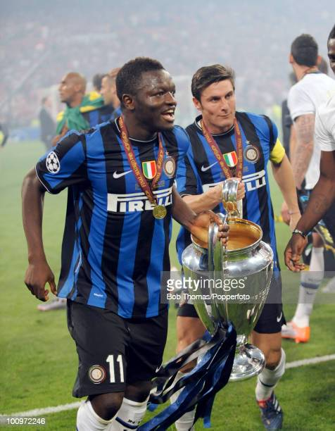Sulley Muntari and captain Javier Zanetti of Inter Milan celebrate with the trophy after winning the UEFA Champions League Final match between Bayern...