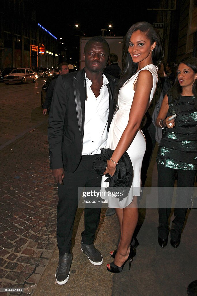 Sulley Muntari and his wife are seen during Milan Fashion Week Womenswear S/S 2011 on September 26, 2010 in Milan, Italy.
