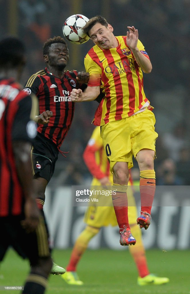 Sulley Muntari of AC Milan and <a gi-track='captionPersonalityLinkClicked' href=/galleries/search?phrase=Lionel+Messi&family=editorial&specificpeople=453305 ng-click='$event.stopPropagation()'>Lionel Messi</a> of FC Barcelona #10 compete for the ball during the UEFA Champions League Group H match between AC Milan and Barcelona at Stadio Giuseppe Meazza on October 22, 2013 in Milan, Italy.