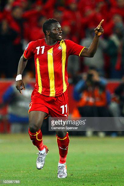Sulley Muntari of Ghana celebrates scoring the opening goal with team mates during the 2010 FIFA World Cup South Africa Quarter Final match between...