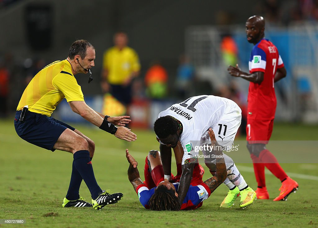 Sulley Muntari of Ghana reacts angrily after a challenge by <a gi-track='captionPersonalityLinkClicked' href=/galleries/search?phrase=Jermaine+Jones+-+Soccer+Player&family=editorial&specificpeople=12906336 ng-click='$event.stopPropagation()'>Jermaine Jones</a> of the United States as referee Jonas Eriksson runs on during the 2014 FIFA World Cup Brazil Group G match between Ghana and the United States at Estadio das Dunas on June 16, 2014 in Natal, Brazil.