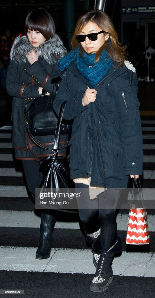 Sulli and Luna of South Korean girl group f(x) is seen at Incheon International Airport on December 23, 2012 in Incheon, South Korea.