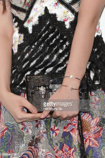 Sulli bag detail of girl group f attends the photocall for Volez Voguez Voyagez Louis Vuitton Exhibition at DDP on June 7 2017 in Seoul South Korea