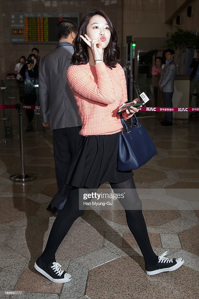Sulli of girl group f(x) is seen on departure at Gimpo International Airport on October 25, in Seoul, South Korea.