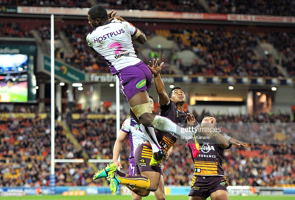 Sullies Vunivalu of the Storm out jumps Anthony Milford of the Broncos to score a try during the round 17 NRL match between the Brisbane Broncos and the Melbourne Storm at Suncorp Stadium on July 1, 2016 in Brisbane, Australia.