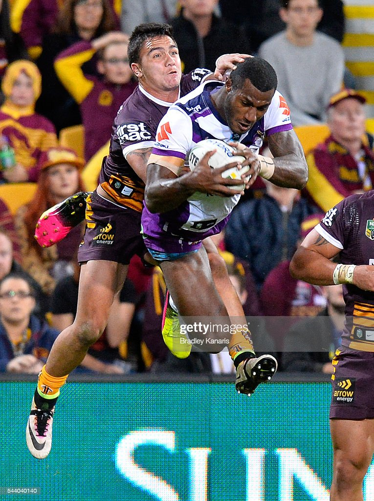 Sullies Vunivalu of the Storm out jumps Kodi Nikorima of the Broncos to score the try during the round 17 NRL match between the Brisbane Broncos and the Melbourne Storm at Suncorp Stadium on July 1, 2016 in Brisbane, Australia.