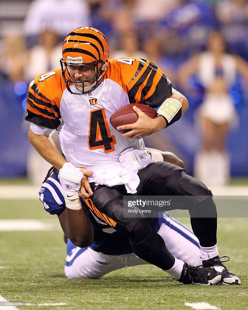 Sullivan of the Cincinnati Bengals is sacked by Ricardo Mathews of the Indianapolis Colts during the NFL preseason game at Lucas Oil Stadium on...