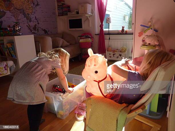 SULLIVANSwedish family Maerestad's children play in their room in their home in Stockholm Sweden on October 13 2013 Sweden had a head start in the...