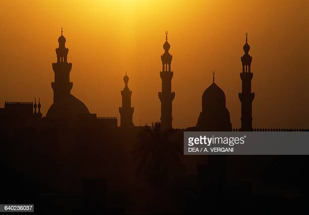 Sultan Hassan and AlRifa'i mosques' minarets at sunset Cairo Egypt