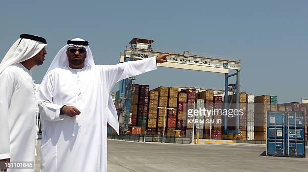 Sultan Jaber chairman of the Abu Dhabi Ports Company gestures as he stands on the dock during the opening of the new Khalifa Port in Abu Dhabi on...