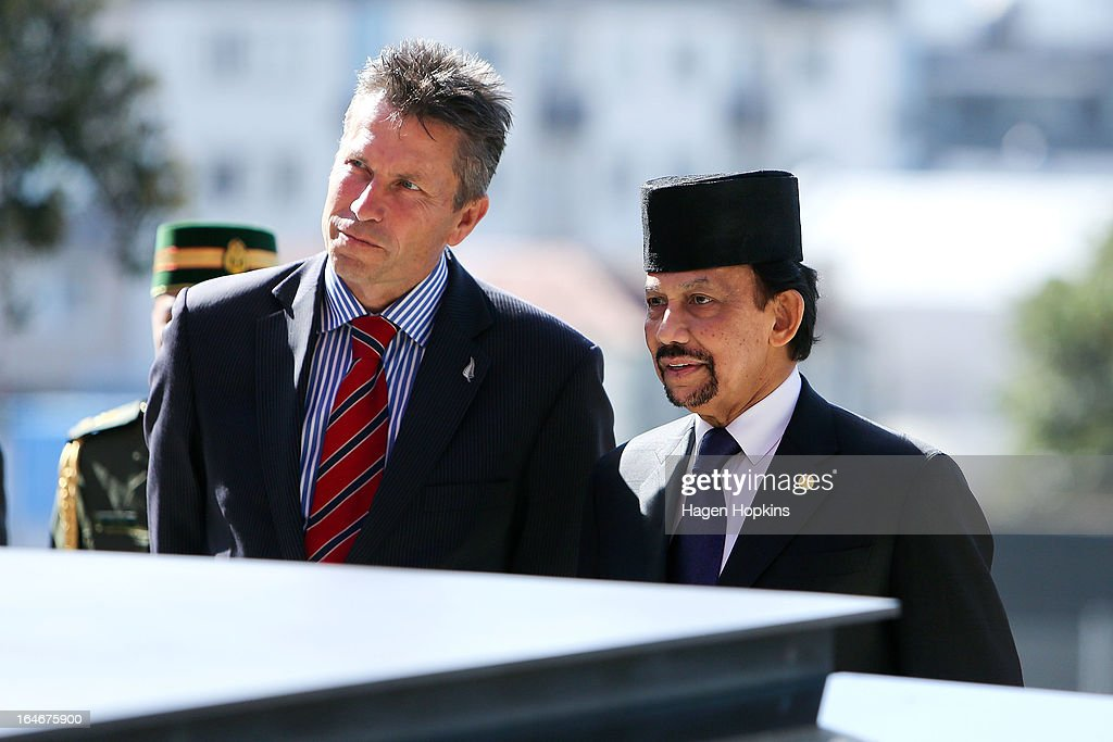 Sultan of Brunei Darussalam, His Majesty Hassanal Bolkiah and MP Chris Tremain look on during a wreath-laying ceremony at the National War Memorial on March 26, 2013 in Wellington, New Zealand. The Sultan of Brunei is being hosted in New Zealand for an official visit over four days to strengthen ties between the two countries ahead of the Association of South East Asian Nations which is being hosted by Brunei later this year.