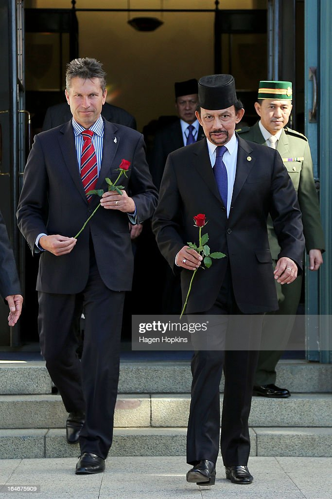 Sultan of Brunei Darussalam, His Majesty Hassanal Bolkiah and MP Chris Tremain make their way to lay roses on the tomb of the unknown warrior during a wreath-laying ceremony at the National War Memorial on March 26, 2013 in Wellington, New Zealand. The Sultan of Brunei is being hosted in New Zealand for an official visit over four days to strengthen ties between the two countries ahead of the Association of South East Asian Nations which is being hosted by Brunei later this year.