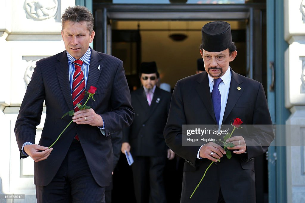 Sultan of Brunei Darussalam, His Majesty Hassanal Bolkiah and MP Chris Tremain lay roses on the tomb of the unknown warrior during a wreath-laying ceremony at the National War Memorial on March 26, 2013 in Wellington, New Zealand. The Sultan of Brunei is being hosted in New Zealand for an official visit over four days to strengthen ties between the two countries ahead of the Association of South East Asian Nations which is being hosted by Brunei later this year.