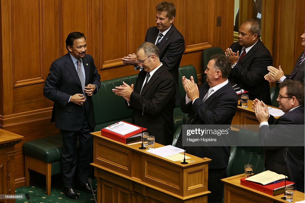 Sultan of Brunei Darussalam, His Majesty Hassanal Bolkiah (L) is welcomed by MPs in the House of Representatives during a visit to Parliament on March 27, 2013 in Wellington, New Zealand. The Sultan of Brunei is being hosted in New Zealand for an official visit over four days to strengthen ties between the two countries ahead of the Association of South East Asian Nations which is being hosted by Brunei later this year.