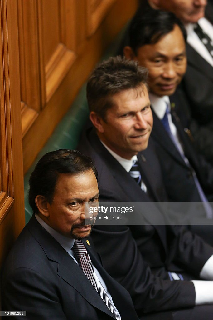 Sultan of Brunei Darussalam, His Majesty Hassanal Bolkiah observes question time with MP Chris Tremain in the House of Representatives during a visit to Parliament on March 27, 2013 in Wellington, New Zealand. The Sultan of Brunei is being hosted in New Zealand for an official visit over four days to strengthen ties between the two countries ahead of the Association of South East Asian Nations which is being hosted by Brunei later this year.