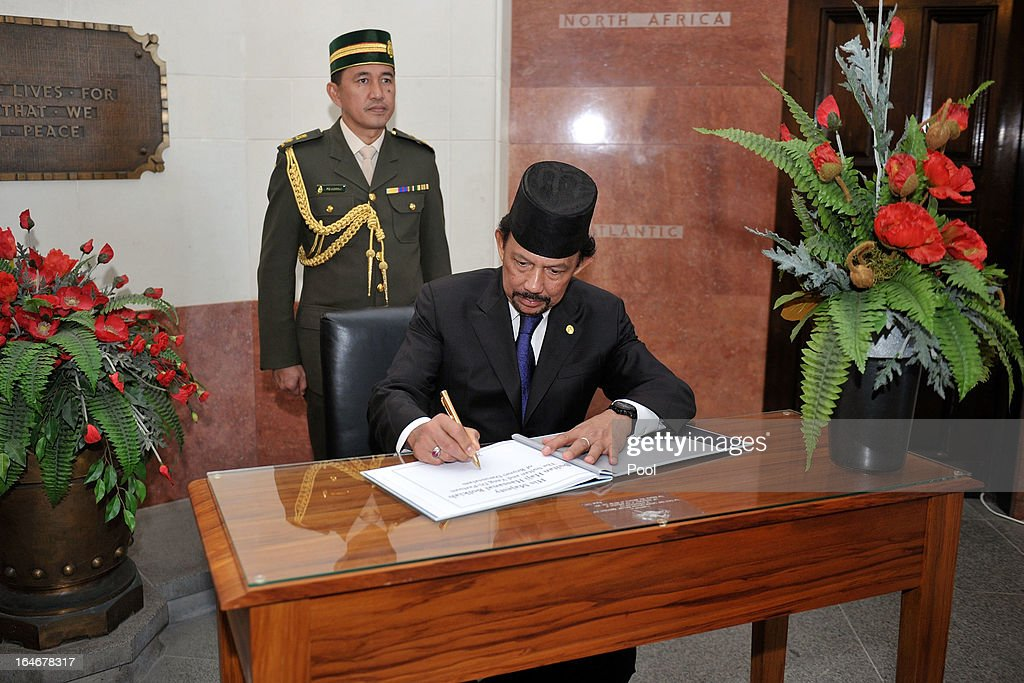 Sultan of Brunei Darussalam, His Majesty Hassanal Bolkiah signs a book recognising a wreath-laying ceremony at the National War Memorial on March 26, 2013 in Wellington, New Zealand. The Sultan of Brunei is being hosted in New Zealand for an official visit over four days to strengthen ties between the two countries ahead of the Association of South East Asian Nations which is being hosted by Brunei later this year.